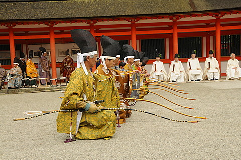 Archers at the archery ceremonial kneeling at shooting position in Shimogamo Shrine, Kyoto, Japan, Asia