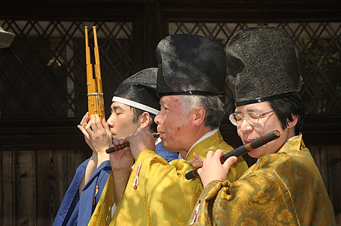 Musician at the Matsuri, shrine festival at the Hirano Shrine, with a wooden mouth organ, Sho, Japanese flute, Ryuteki, flute, Hichiriki, in the Hirano Shrine, Kyoto, Japan, Asia