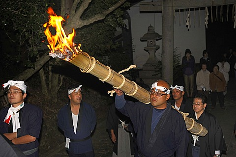 For a fire-Matsuri in Autumn torches are lit in each district and carried through the streets to the Shinto shrine, Iwakura in Kyoto, Japan, Asia