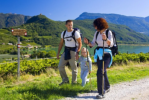 Family hiking on Lake Kaltern, province of Bolzano-Bozen, Italy, Europe