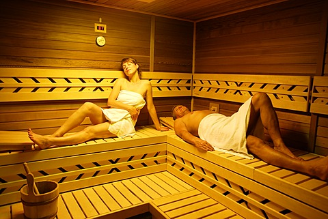 Couple in a sauna, woman, 35 years, and man, 54 years