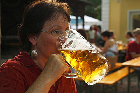 Woman drinking a litre of beer, Beer Garden at the Flaucher, Thalkirchen, Munich, Bavaria, Germany, Europe