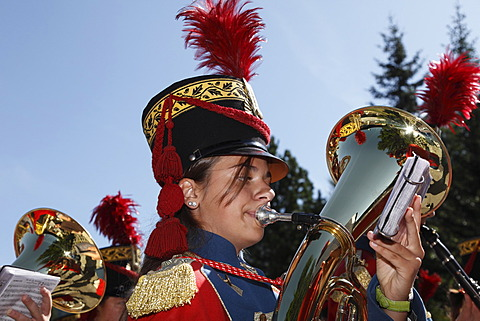 Young woman playing the tuba, local music group, at the Samson Parade, St. Michael, Lungau, Salzburg state, Salzburg, Austria, Europe