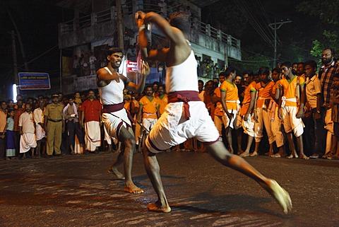 Martial arts demonstration, temple festival in Pulinkudi, Kerala state, India, Asia