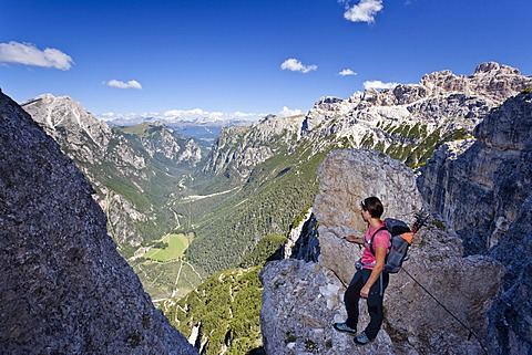 Mountain climber ascending Monte Piano climbing route, Alta Pusteria, in front of the Val di Landro Valley, Dolomites, Alto Adige, Italy, Europe