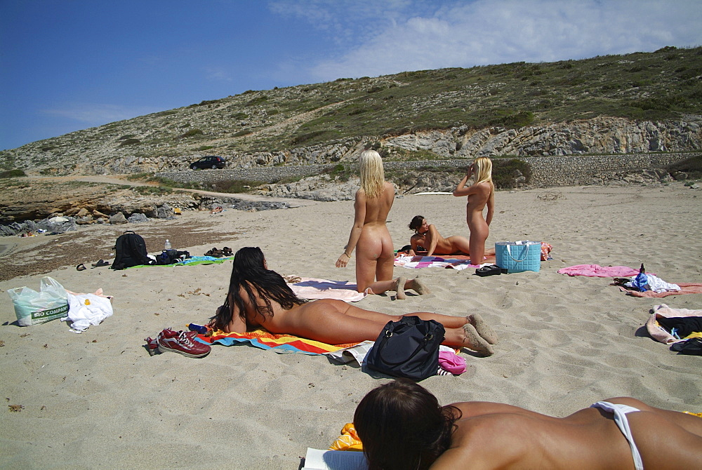 Five young women tanning nude at a beach in Mallorca, Balearic Islands, Spain, Europe