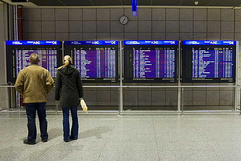 Passengers in front of flight info display screens, Terminal 2, Frankfurt Airport, Frankfurt, Hesse, Germany, Europe