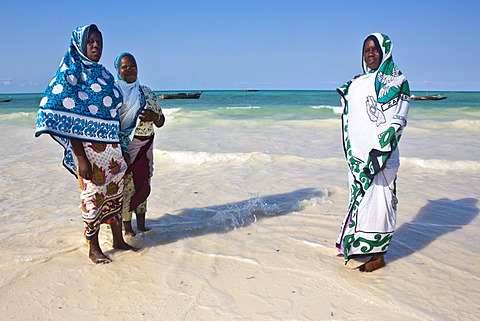 Muslim women on the beach in Zanzibar, Tanzania, Africa