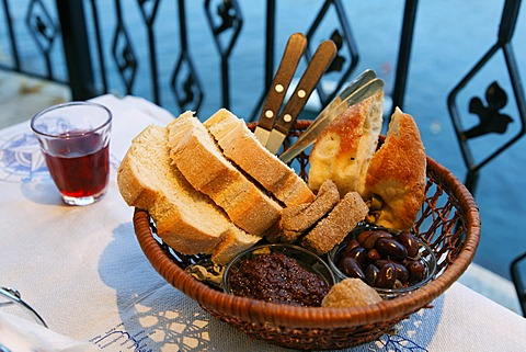 Typical bread basket with olives, Crete, Greece