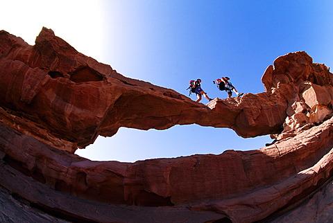 Trekking, stone arch, Wadi Rum, Jordan, Asia