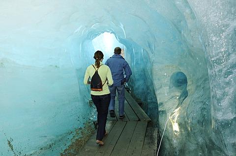 Hikers in a glacier cave, Rhone Glacier, Furka Pass, Uri, Switzerland, Europe