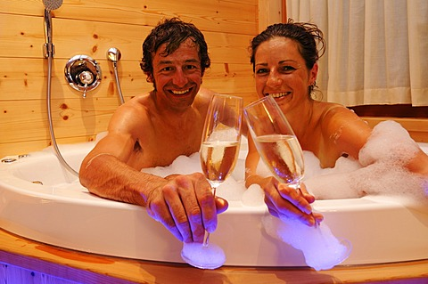 Couple in a jacuzzi, Post Alpina hotel, Alta Pusteria, South Tyrol, Dolomites, Italy,