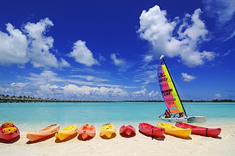 Kayaks and a catamaran on the beach, St. Regis Bora Bora Resort, Bora Bora, Leeward Islands, Society Islands, French Polynesia, Pacific Ocean