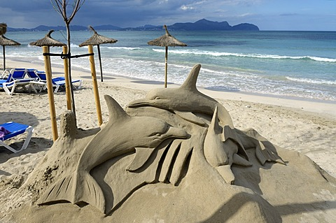 Dolphins as sand sculptures on the beach of C'an Picanfort, Majorca, Mallorca, Balearic Islands, Spain, Europe