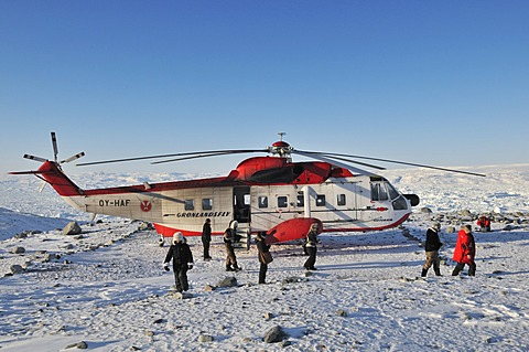 Sikorsky helicopter flying tourists to icebergs in the Ilulissat Fjord, Greenland, Arctic North America