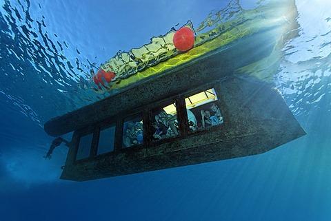 People waving from the yellow submarine Sinbad, Makadi Bay, Hurghada, Egypt, Red Sea, Africa