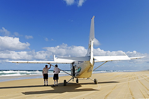 Pilotes and plane on the 75-Mile Beach, Fraser Island, Queensland, Australia