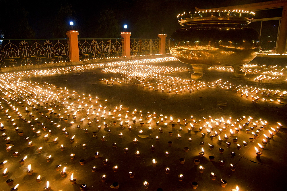 "Butter lamps at the Mahabodhi Temple, place of enlightenment or awakening, ""Bodhi"" of Siddhartha Gautama, Bodhgaya, Bihar, India, Asia"