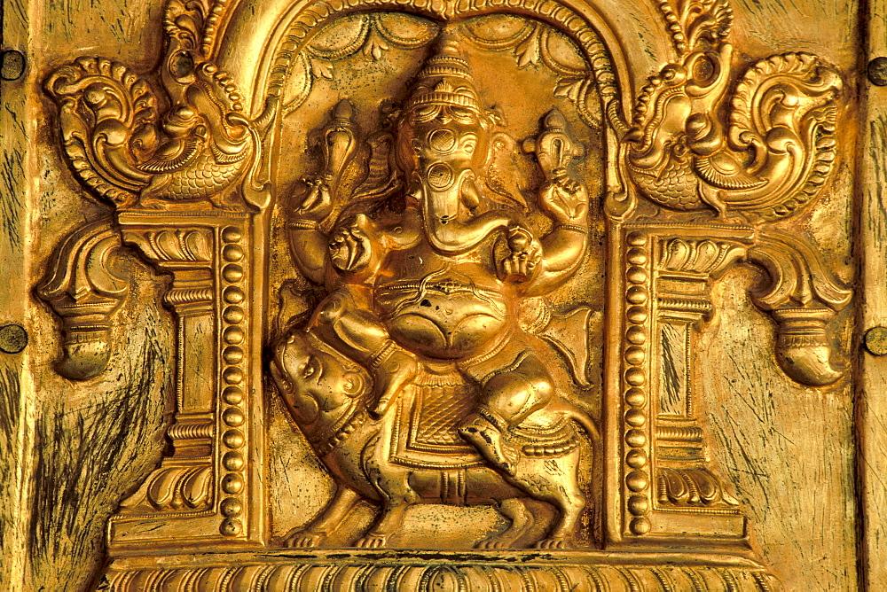 Hindu elephant-headed god Ganesha, Ganesh or Ganpati mounted on a rat, gilded relief, Madurai, Tamil Nadu, South India, India, Asia