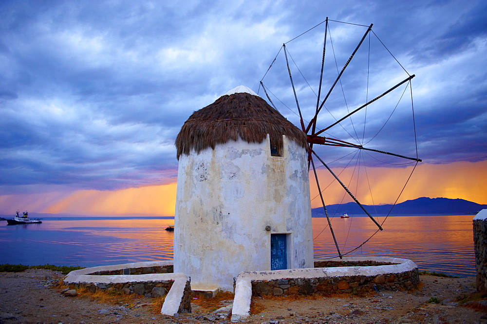 Sunset over the traditional Greek windmills of Mykonos Chora, Cyclades Islands, Greece, Europe - 832-372718