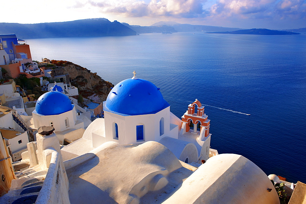 Blue domed Byzantine Orthodox churches, Oia, Ia, Santorini, Cyclades Islands, Greece, Europe - 832-372770