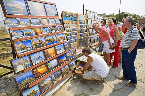 Tourists in front of stalls with pictures of the fortress of Akkerman in Bilhorod-Dnistrowskyj, Ukraine, Eastern Europe