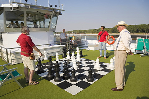 "Passengers on a Danube cruise playing chess on deck of the ""MS Amadeus Royal"" near Galati, Romania, Europe"