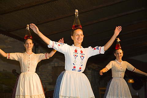 """The folklore dance group """"Domjan"""" is dancing in a Csarda, a traditional Hungarian tavern, Budapest, Hungary"""