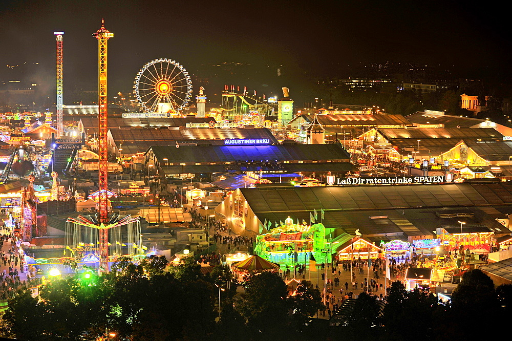 View of the Oktoberfest festival at night, with illuminated stalls, beer tents and funfair rides, Oktoberfest festival, Munich, Upper Bavaria, Bavaria, Germany, Europe
