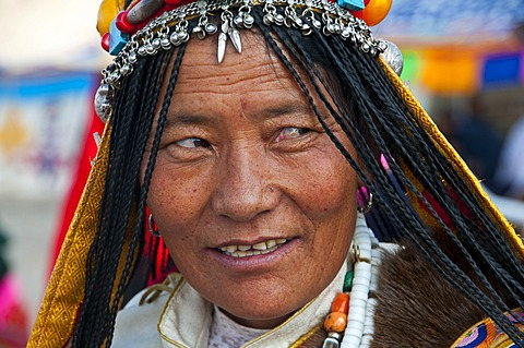 Traditionally dressed woman on the festival of the tribes in Gerze, Western Tibet, Asia