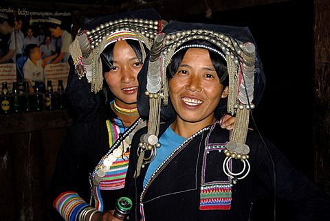 Portrait, ethnology, young Akha Pixor women smiling and wearing silver headdresses and coins, village of Ban Moxoxang, Phongsali, Phongsali district, Laos, Southeast Asia, Asia