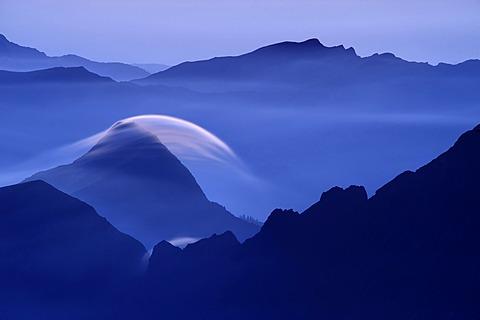 Peaks at the blue hour with rolling cloud, Lenticularis, Warth, Vorarlberg, Austria, Europe