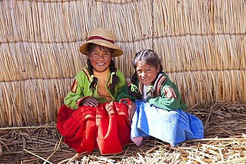 Two young girls, floating Uro Island, Lake Titicaca, Puno, Peru, South America