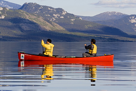 Canoeists, evening, Lake Laberge, Yukon Territory, Canada, North America