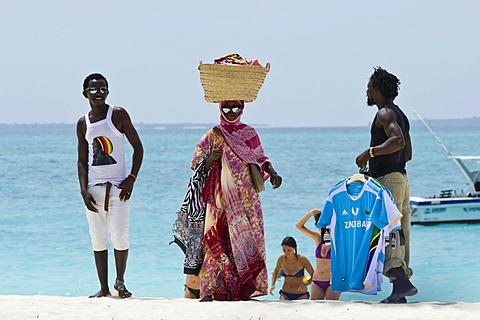 Souvenir vendors on the beach of Kendwa Rocks, north coast of Zanzibar, Tanzania, Africa