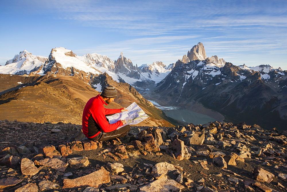 Hiker at the Loma del Pliegue Tumbado, views of Cerro Torre and the Fitz Roy massif, Los Glaciares National Park, El Chaltén, Santa Cruz, Argentina
