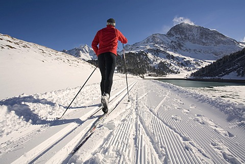 Cross-country skier, right the Laengental Reservoir, Kuehtai, Sellrain Valley, Tyrol, Austria