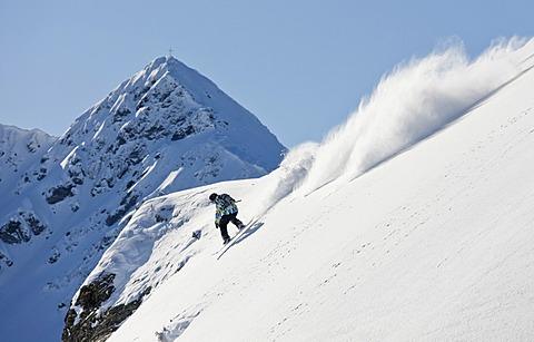 Freerider, snowboarder descending, in front of Standkopf Mountain, Sagtaler Spitze Mountain, Alpbach Valley, Kitzbühel Alps, North Tyrol, Austria