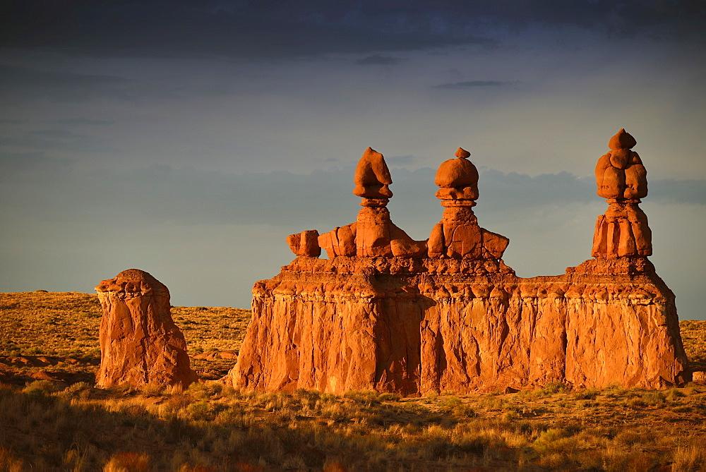 Three Sisters rock formations, thunderstorm, eroded entrada sandstone hoodoos and rock formations, Goblins, Goblin Valley State Park, San Rafael Reef Desert, Utah, Southwestern USA, USA