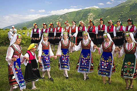 Dance group wearing traditional costumes, Rose Festival, Karlovo, Bulgaria, Europe