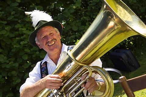 Bavarian tuba player in typical costume, Iffeldorf Upper Bavaria, Germany, MR