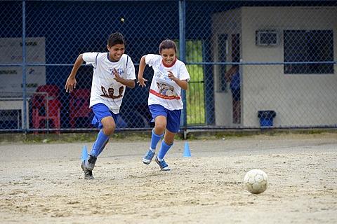 Two teenagers, twins, 16 years, playing football, Craque do Amanha social project, São Gonçalo, Niterói, Rio de Janeiro State, Brazil, South America
