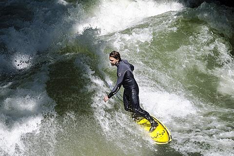 Surfer surfing the Eisbach stream, English Garden, Munich, Upper Bavaria, Bavaria, Germany, Europe
