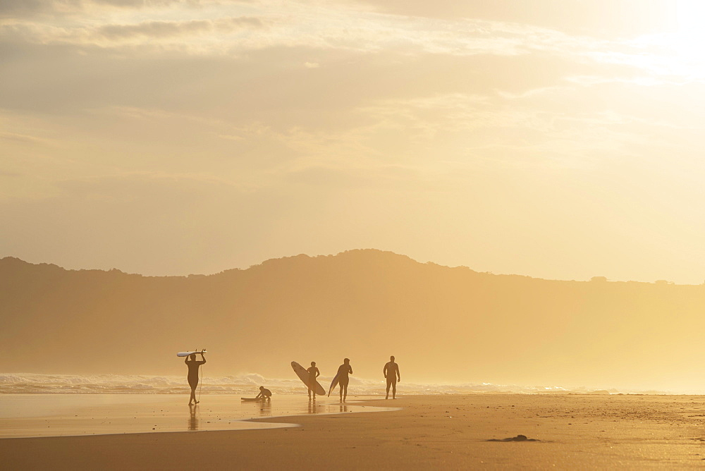 Surfer in the evening in backlight, beach at Sedgefield, South Africa, Africa - 832-378358