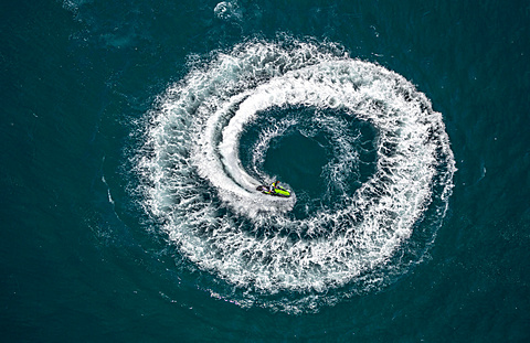 Aerial view, jetski, jetskier performing a circle, off Leucate, Le Barcarès, Languedoc-Roussillon, France, Europe - 832-378377