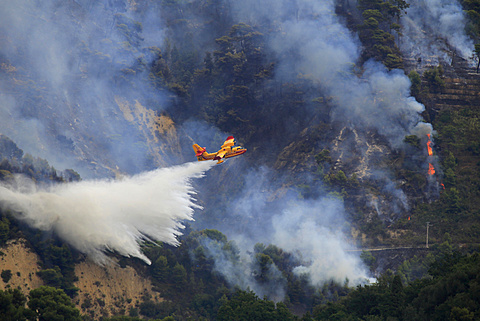 Fire extinction, firefighting aircraft Canadair CL 415, French Sécurité Civile, dropping seawater, large-scale forest fire in Castellar, Maritime Alps