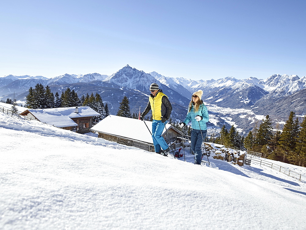 Woman and man, couple hiking with snowshoes in a snowy landscape, Patscherkofel, Patsch, Innsbruck, Tyrol, Austria, Europe