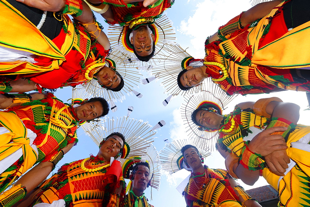 Nagaland tribesmen looking down with heads in a circle, Kisima Nagaland Hornbill festival, Kohima, Nagaland, India, Asia - 832-378799