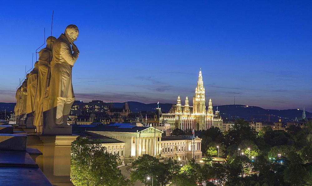 Statues of famous scientists on the roof of the Natural History Museum at night, view of Parliament and the City Hall, Vienna, Austria, Europe - 832-378821