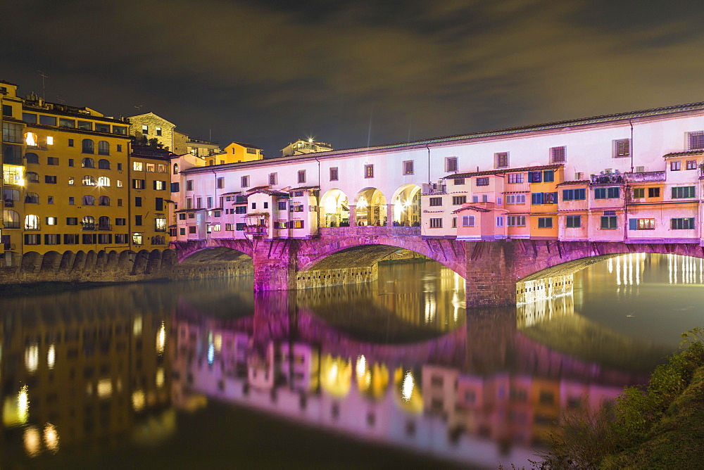 Coloured illuminated Ponte Vecchio by night, Festival of Lights, Arno, Florence, Italy, Europe